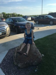 Drew is into having his picture taken all of a sudden. Sitting on a rock outside of the restaurant!